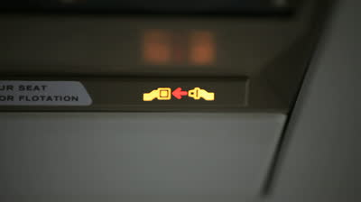 stock-footage-seat-belt-sign-blinking-on-airline